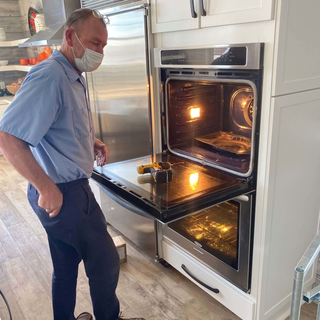 person working on oven